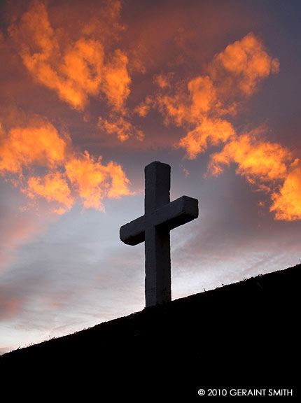 Fiery sky and cross