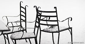 chairs in snow at overland ranch, Taos