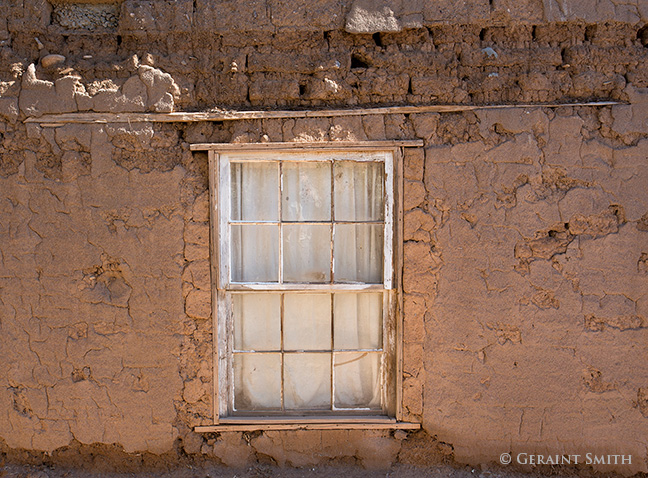 abandoned adobe and window