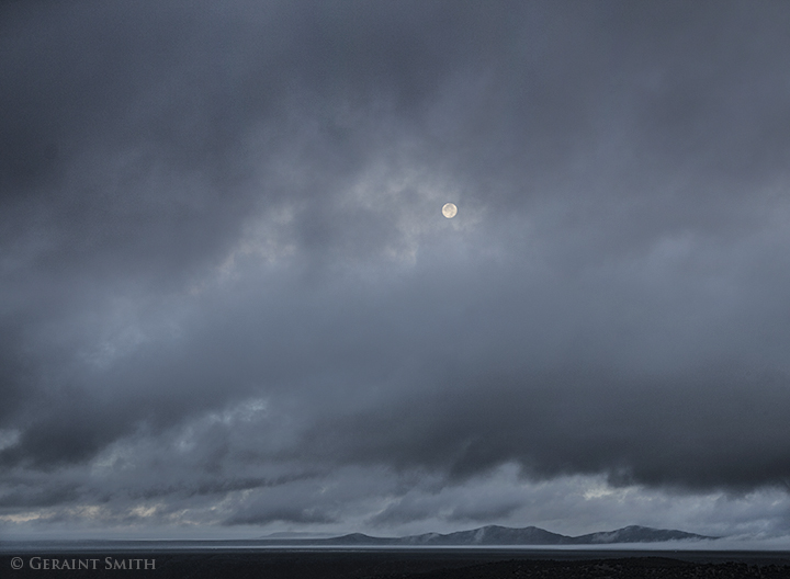 Harvest Moon setting over the Taos volcanic plateau