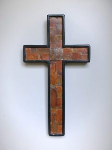 cross black patch work rusted steel