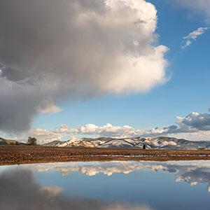 Roadside Reflections, Taos Mountain Clouds