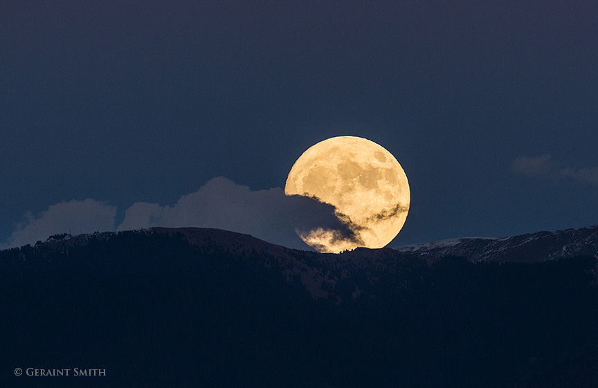 Super Moon rising over Vallecito Peak in the Sangre de Cristo Mountains, east of Taos New Mexico.