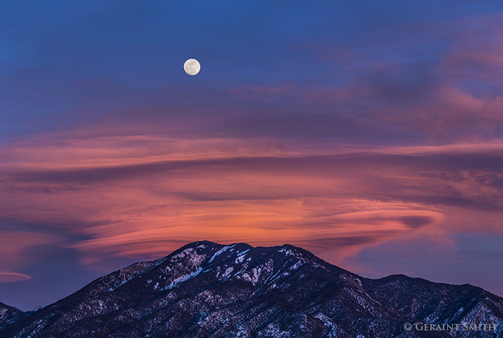 Snow Moon rise over lenticular clouds and taos mountain