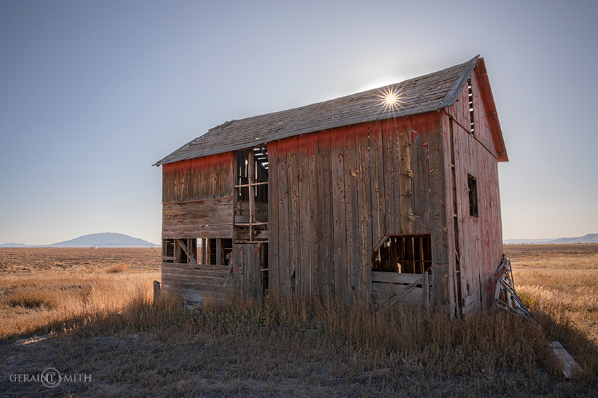 Red Barn, hole in the roof sunset.