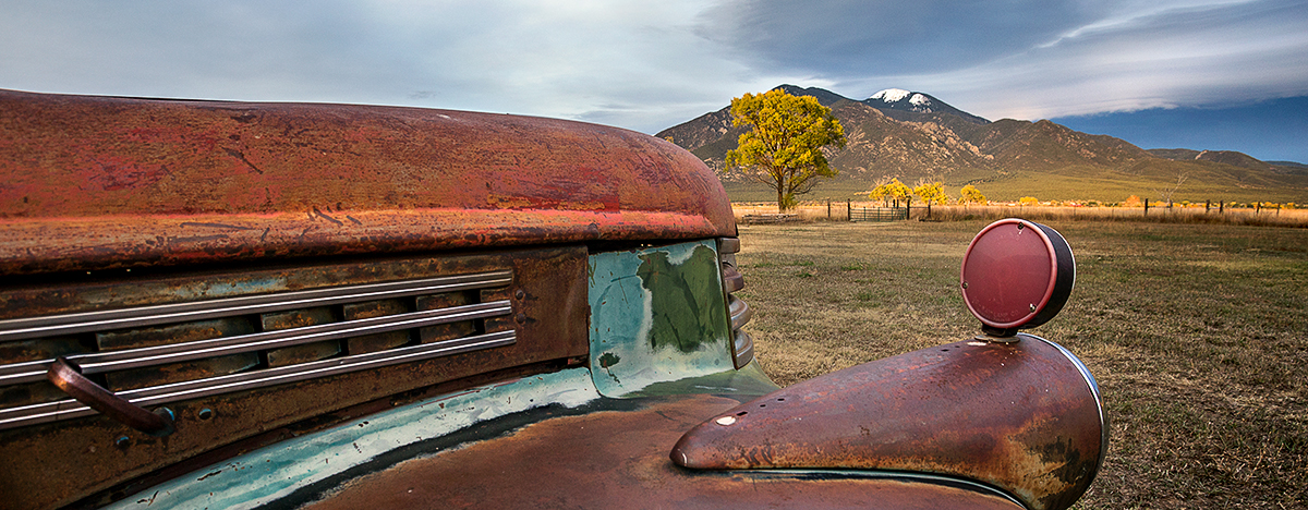 Old trucks, meadows and mountains, Taos NM