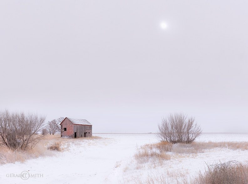 Winter fields, red barn, San Luis Valley, Colorado