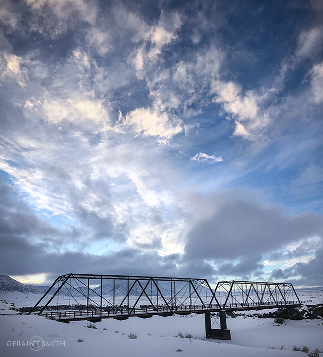 Lobatos steel bridge, crossing the frozen Rio Grande