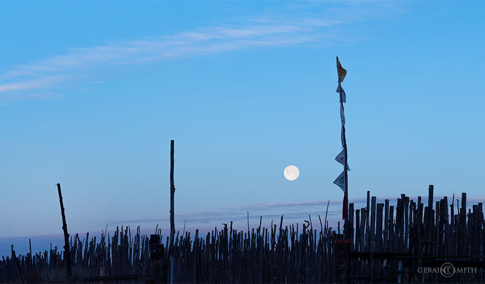 Full moon setting over the coyote fence, Arroyo Hondo, NM
