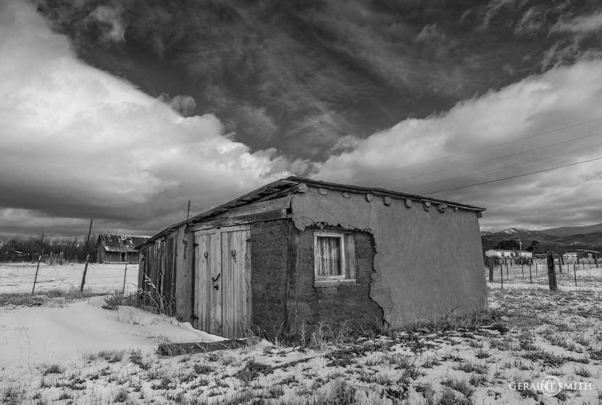 Adobe shed and cloud in Llano de San Juan, NM.