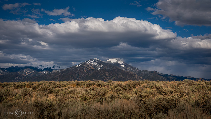 Taos Mountain, spring clouds, sunshine,
