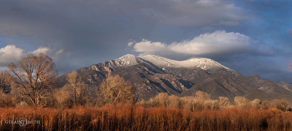 Taos Mountain, red willows, clouds.