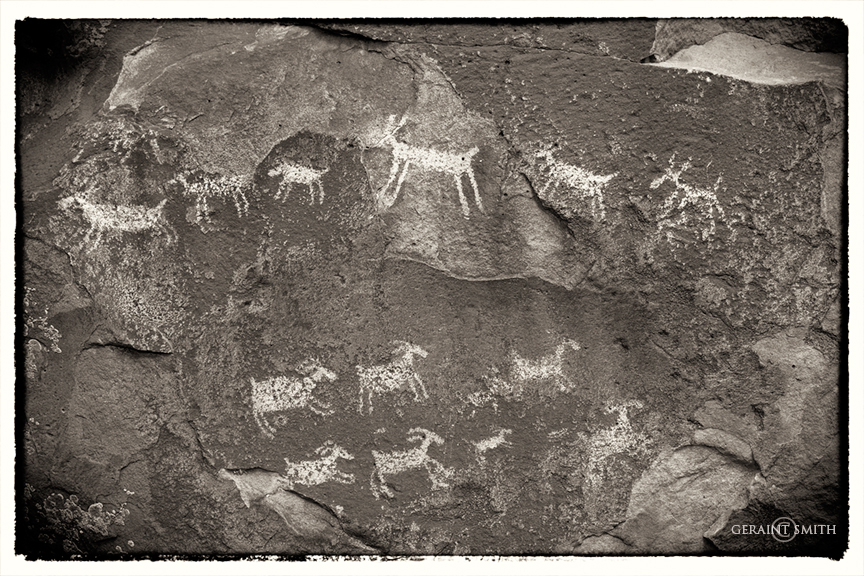 Petroglyphs on a story rock panel in the Rio Grande Del Norte National Monument.