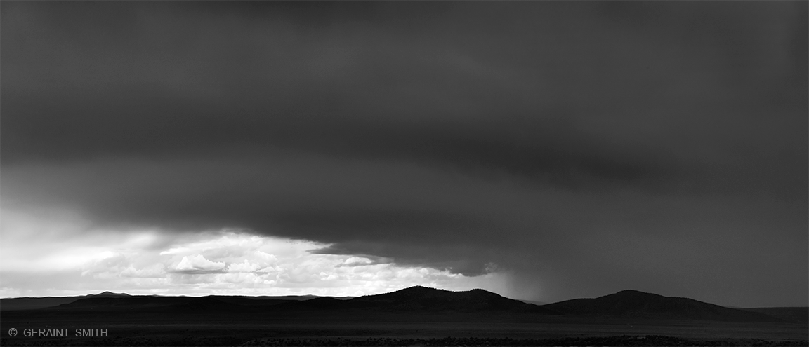 Light, with black clouds, Taos Plateau.