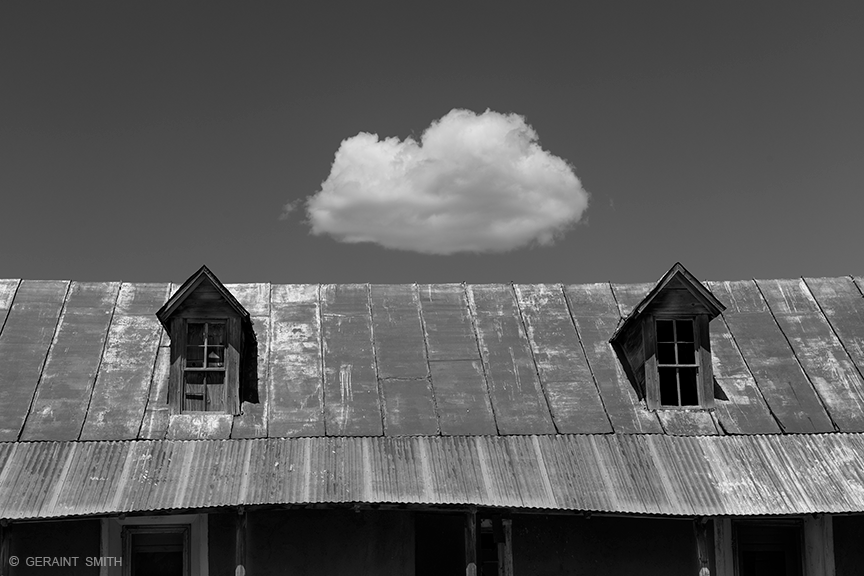 Dormer windows and solitary cloud