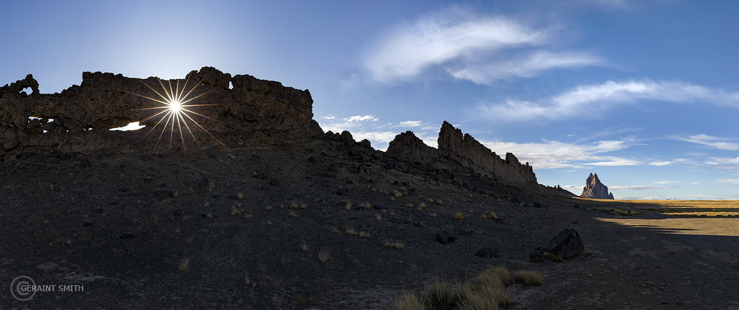 Shiprock with sun star, northwestern New Mexico.