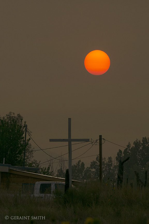Fire smoke sunset cross