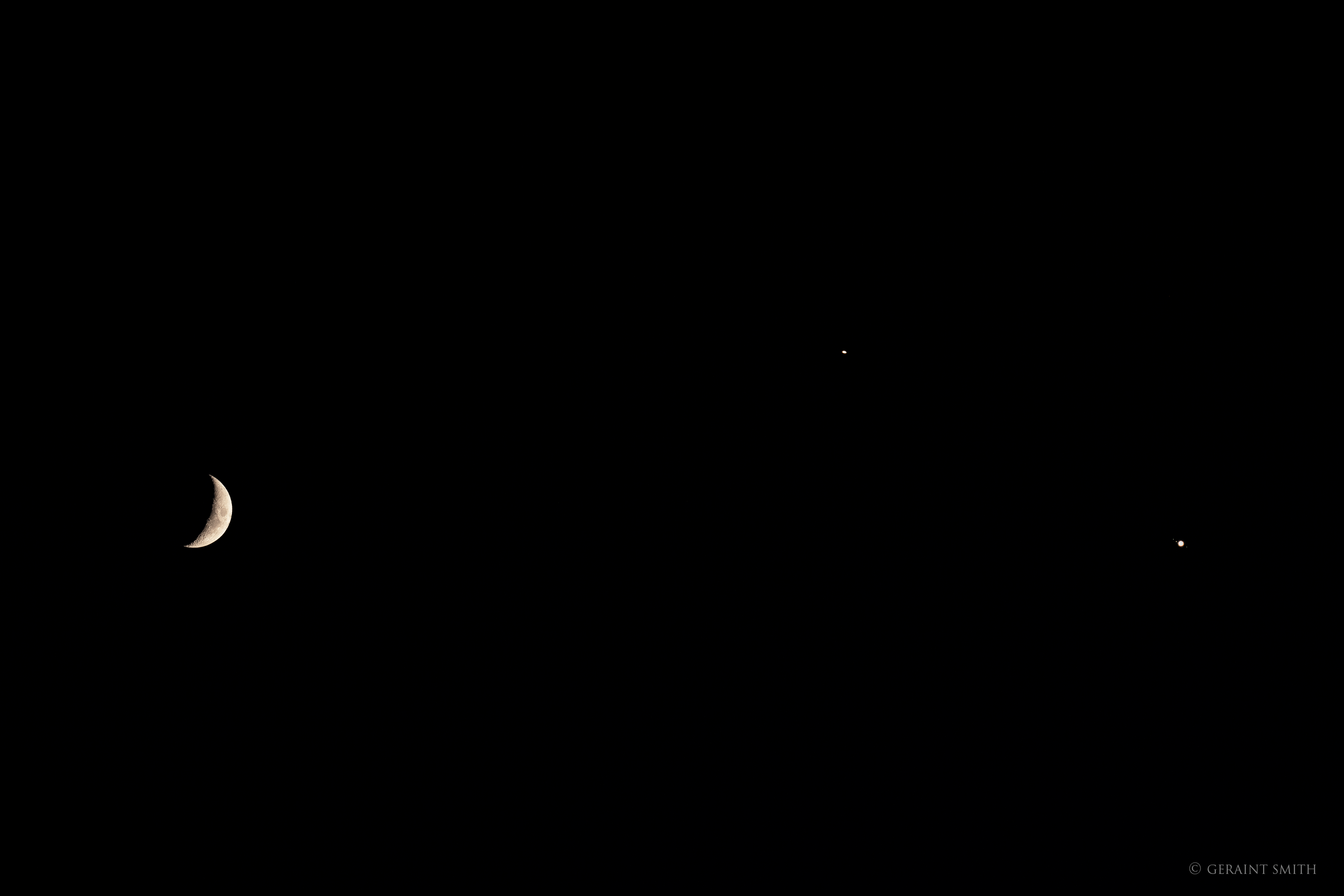 Saturn, Jupiter, with three of its moons, and our Moon.