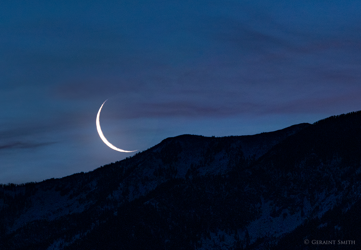Crescent moon rise over Taos Mountain