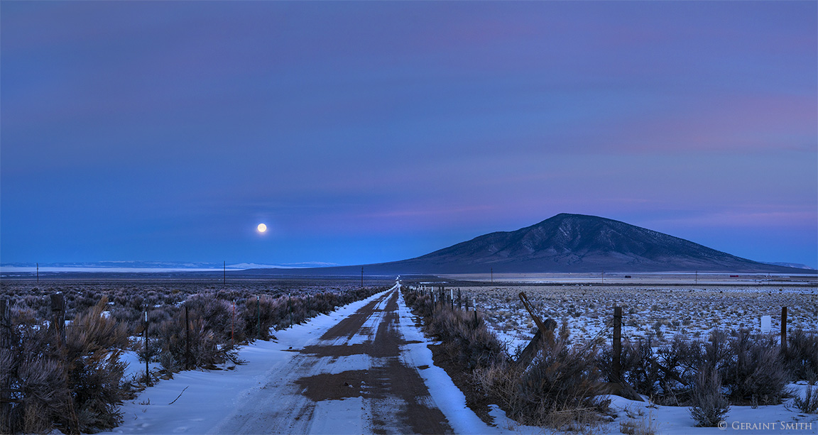 Road to Ute Mountain with the Wolf Moon setting.