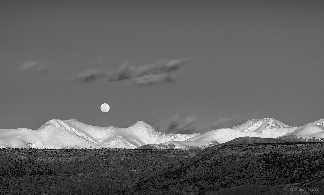 Full worm moon rising over the Sangre de Cristo Mountains of southern Colorado.